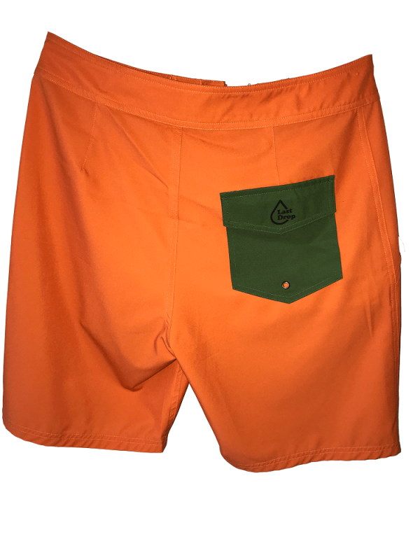 back of orange waterproof bathing suit with green pocket